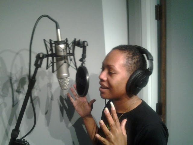 Daree Allen at the microphone in Gerald's booth.